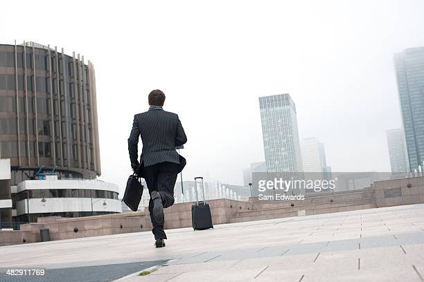 Businessman outdoors runing