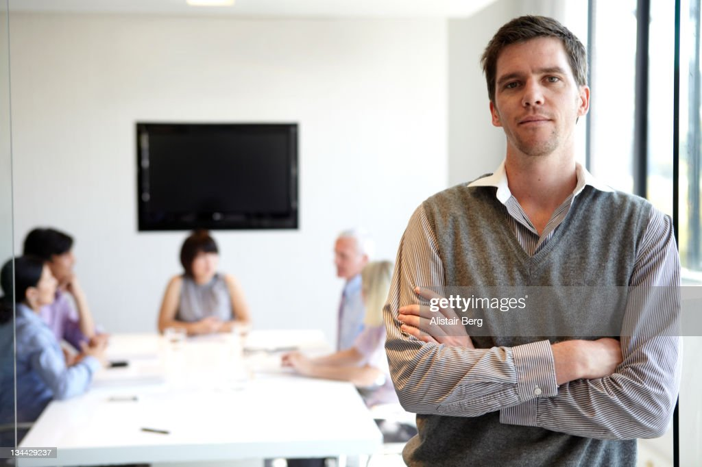 Businessman outside of a meeting : Stock Photo