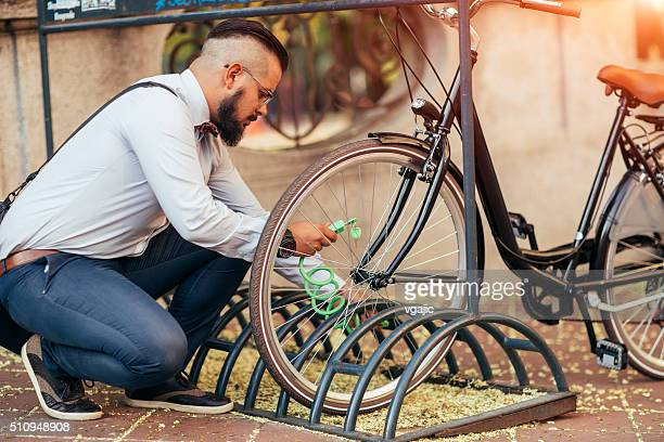 Businessman Parking His Bycycle.
