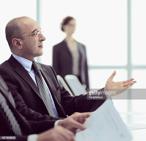 Businessman participating in office meeting