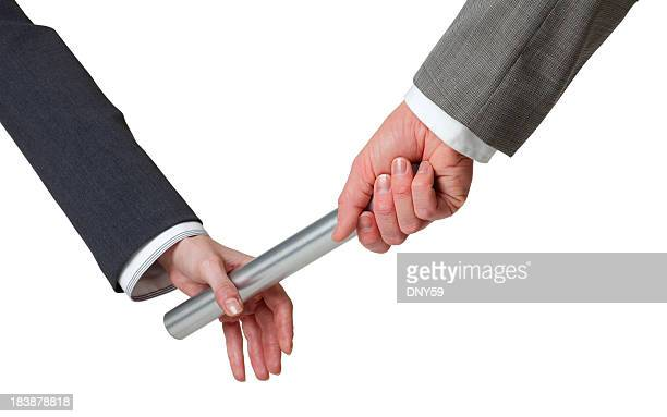 Businessman passing baton to a businesswoman on white background