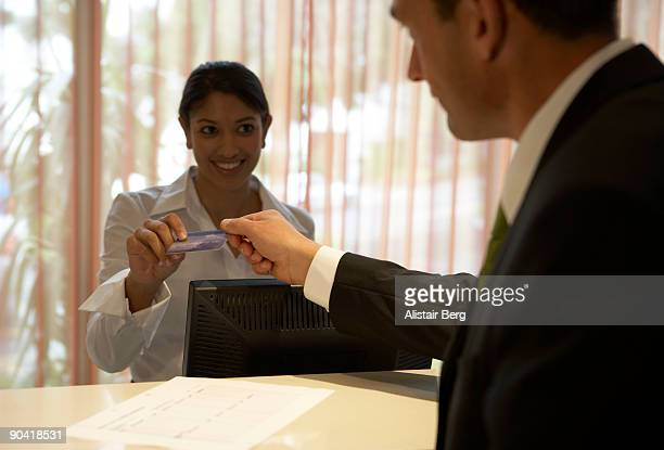 Businessman paying in hotel