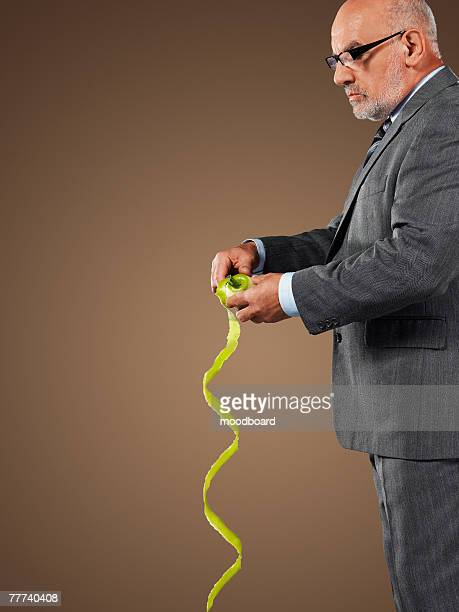 Businessman Pealing an Apple