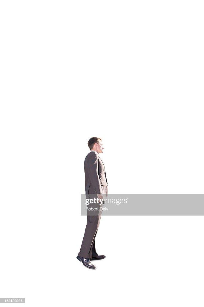 A businessman peeking around the corner : Stock Photo