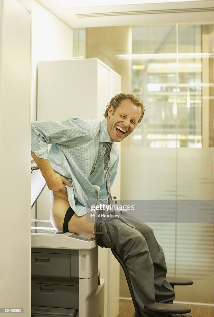 Businessman photocopying his buttocks : Stock Photo
