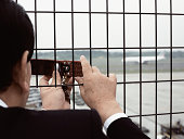 Businessman photographing an airport