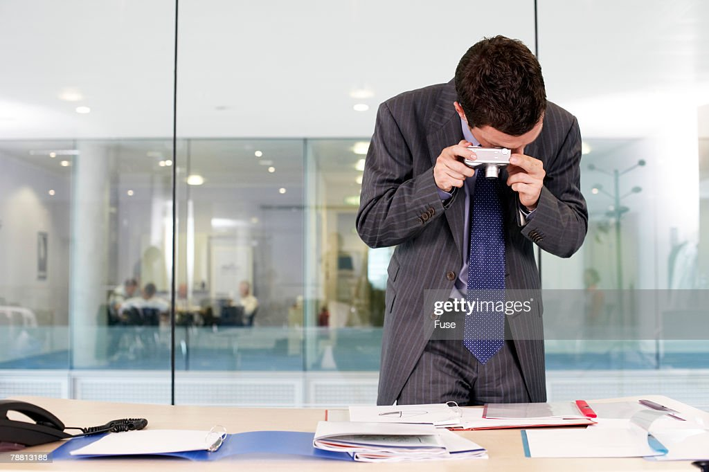 Businessman Photographing Documents