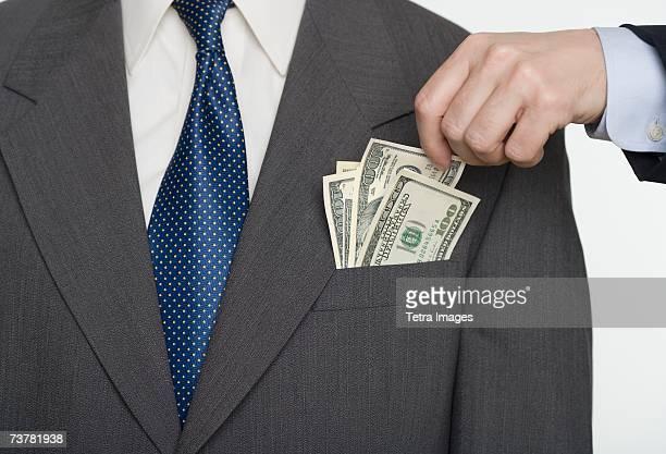 Businessman picking a pocket