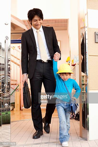Businessman Picking Up Son from Day-care Center