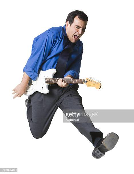 Businessman playing a guitar