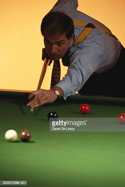 Businessman playing billiards
