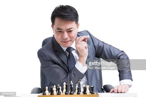 Businessman playing chess