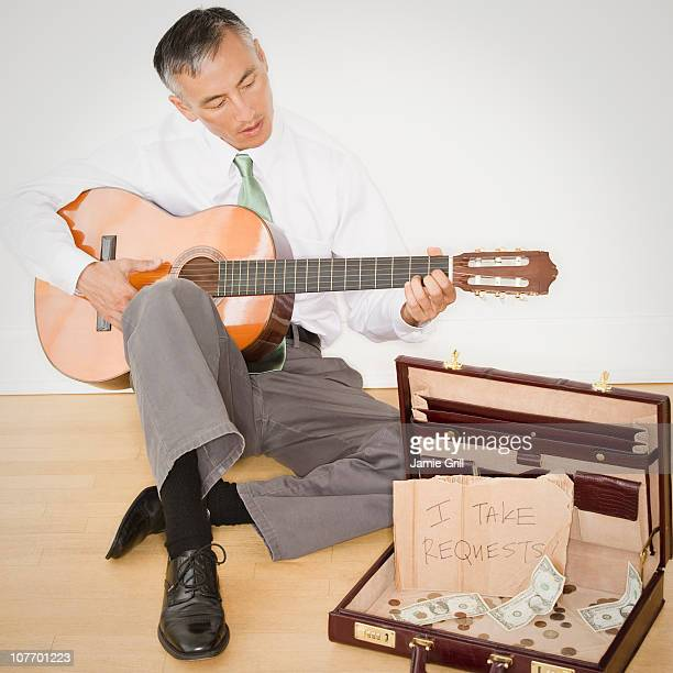 Businessman playing guitar in office