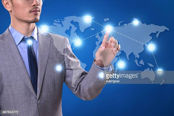 Businessman pointing a social network structure