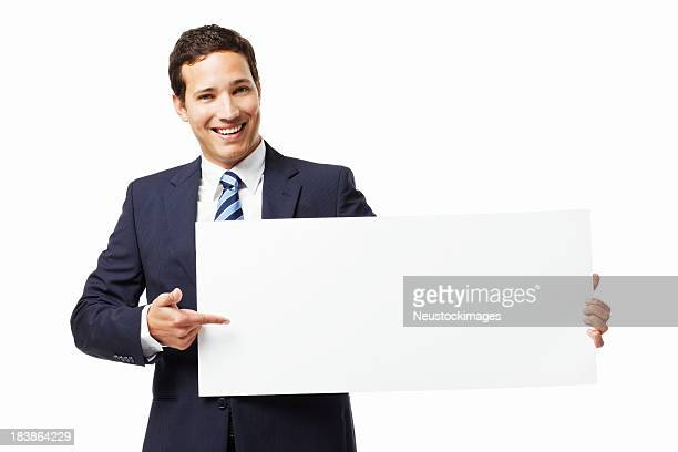 Businessman Pointing at a Blank Sign - Isolated