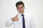 Portrait of confident businessman pointing with his index finger