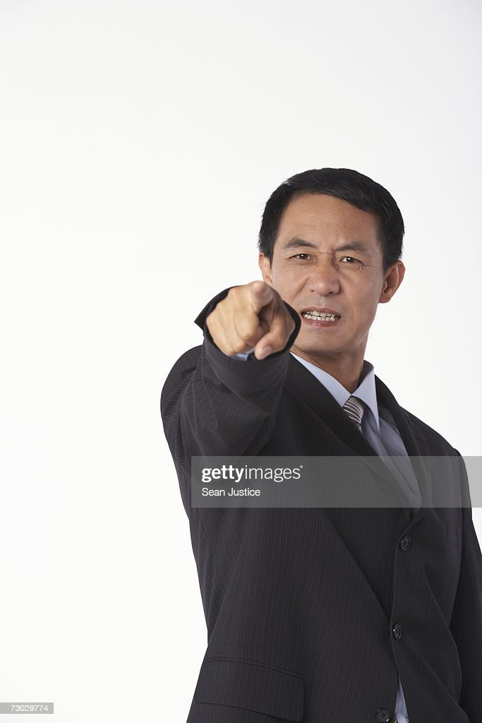 Businessman pointing : Stock Photo