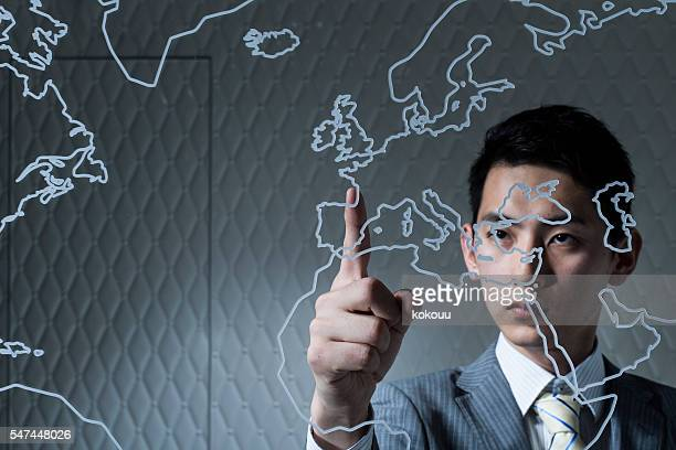 Businessman pointing the European country which will be traded