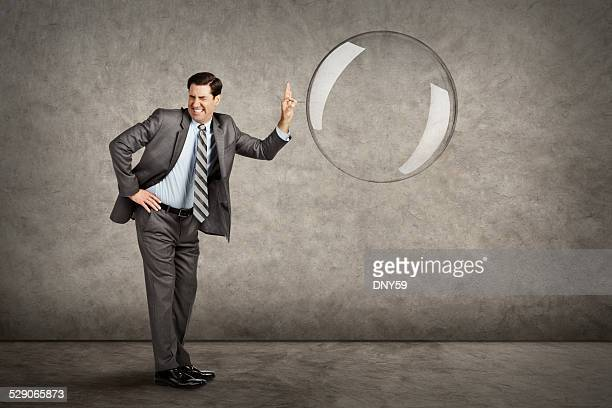 Businessman Popping A Bubble