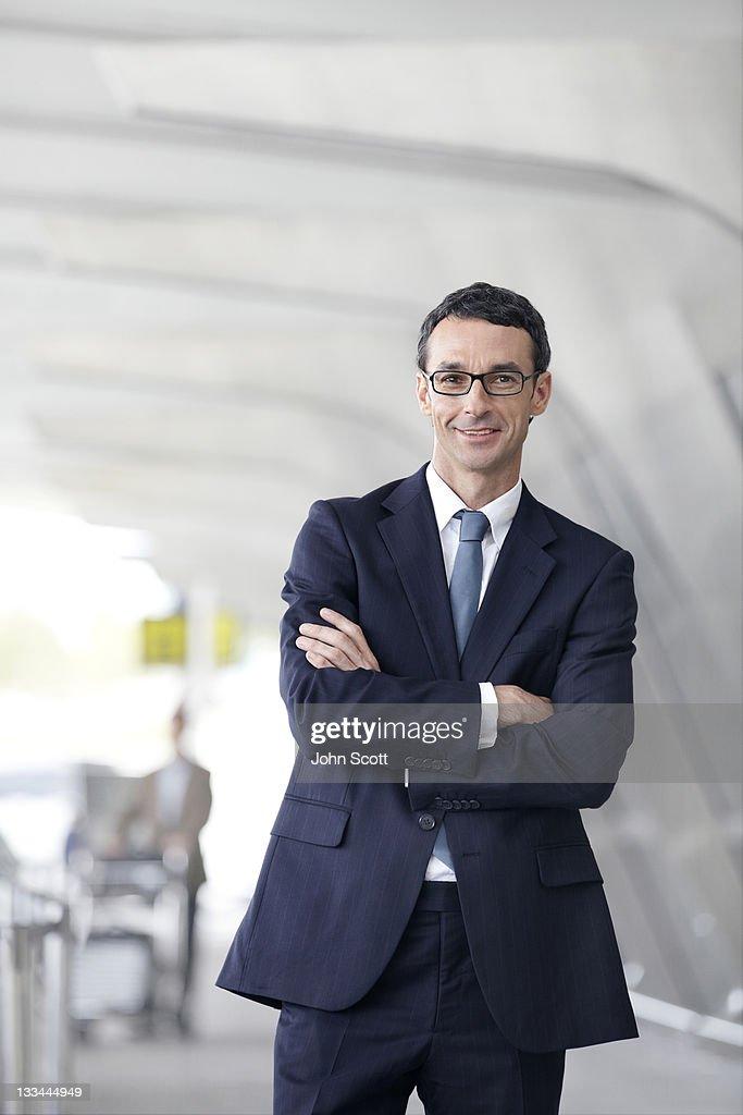 Businessman portrait at airport : Stock Photo