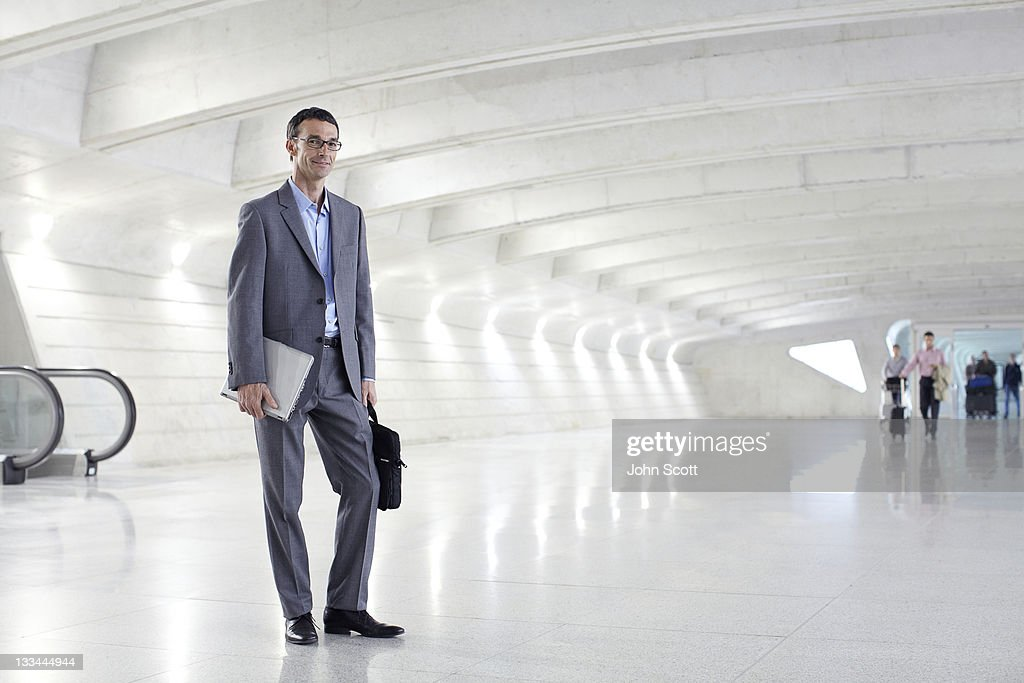 Businessman portrait at an airport : Stock Photo