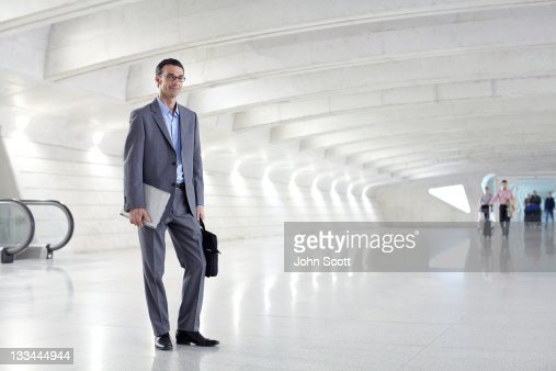 Businessman portrait at an airport : Stock Photo
