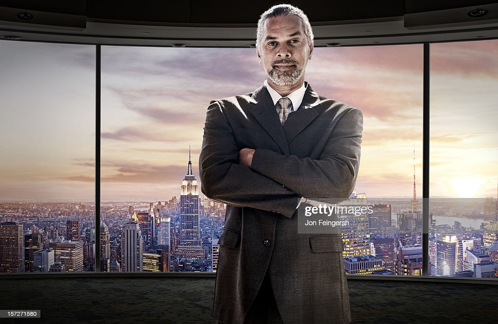 Businessman portrait with cityscape behind : Stock Photo