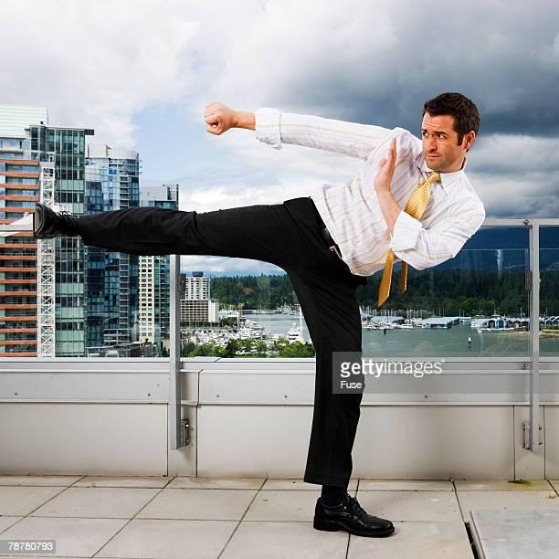Businessman Practicing Martial Arts Downtown
