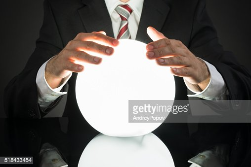 Businessman Predicting Future With Crystal Ball : Stock Photo
