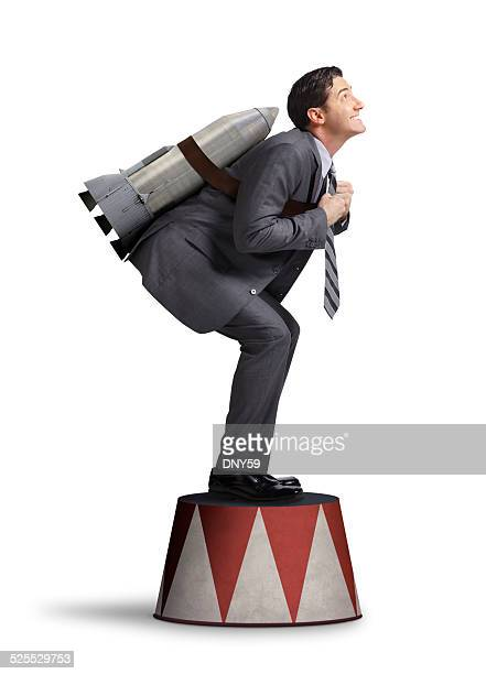 Businessman Preparing For Take Off On Circus Pedestal