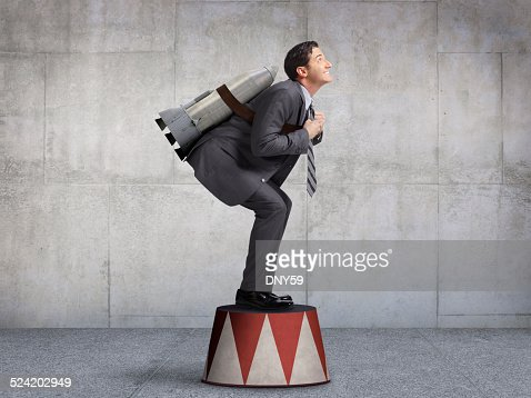 Businessman Preparing For Takeoff On Circus Pedestal