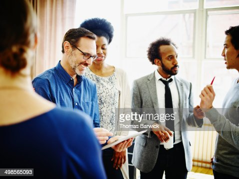 Businessman presenting project to coworkers