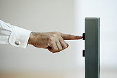 Businessman pressing button for elevator,close up