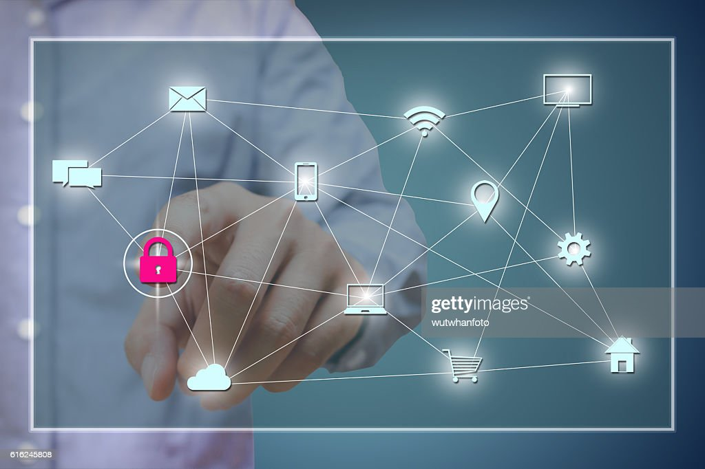 Businessman pressing red security lock button on virtual screens : Stock Photo