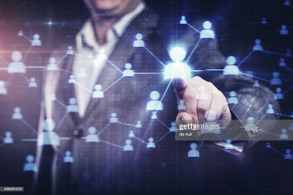 Businessman pressing social network button on modern digital display