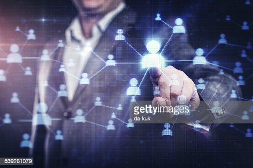 Businessman pressing social network button on modern digital display