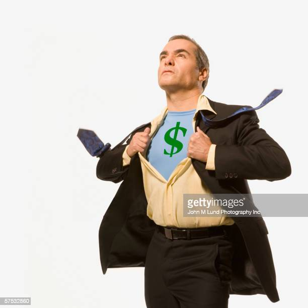 Businessman pulling back his shirt to reveal a dollar-sign superhero outfit