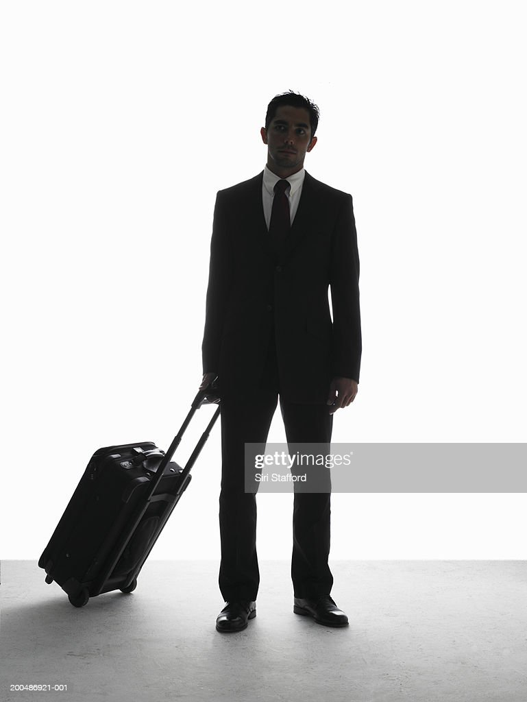 Businessman pulling luggage : Stock Photo