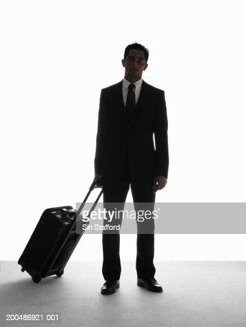 Businessman pulling luggage : Photo