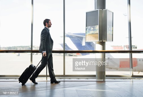 Businessman pulling suitcase