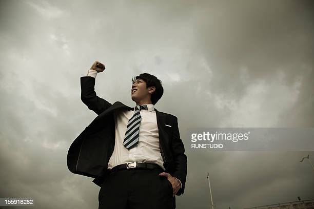 businessman punching air