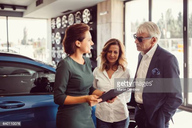 Businessman purchasing modern car