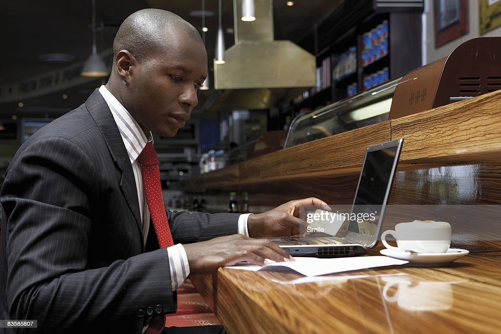 businessman purchasing via the internet : Stock Photo