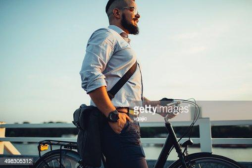 Businessman Pushing Bicycle.