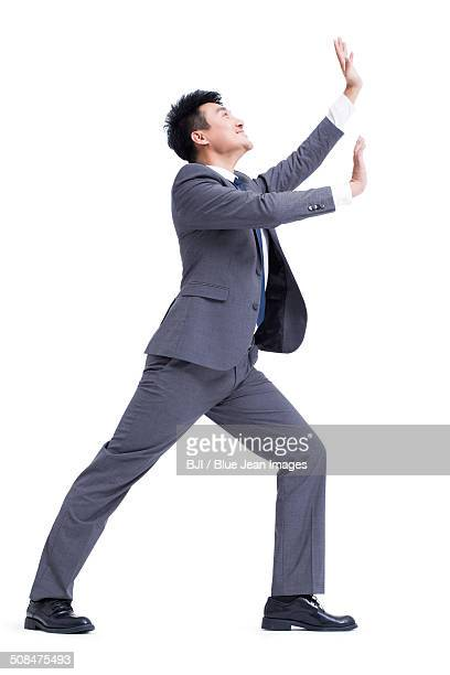 Businessman pushing