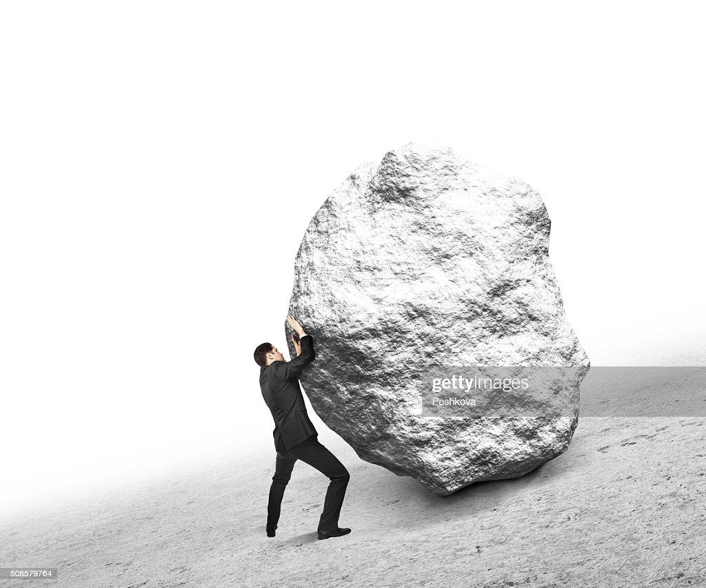 businessman pushing stone : Stock Photo