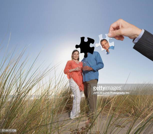 Businessman putting human puzzle together