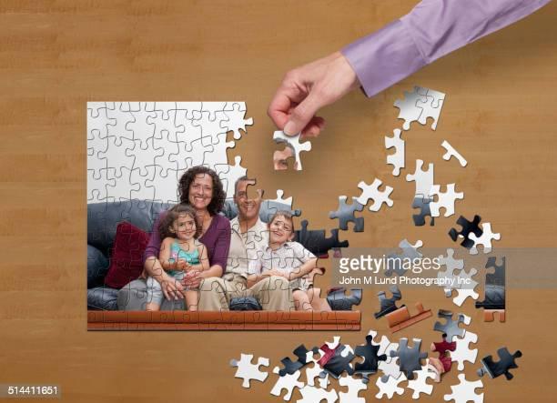 Businessman putting puzzle together on desk