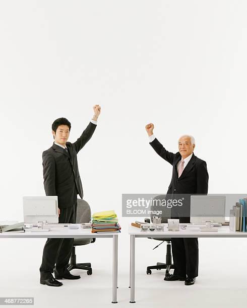 Businessman Raising Their Hands