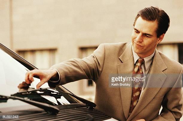 Businessman Reaching for Citation on Car
